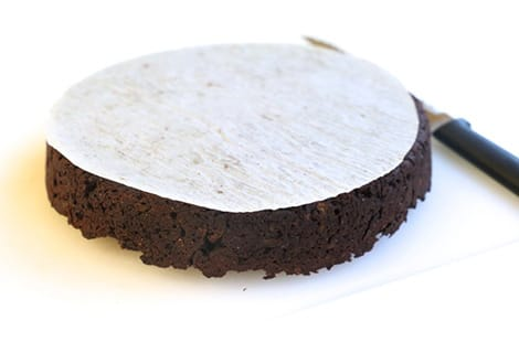 Parchment paper on cake.