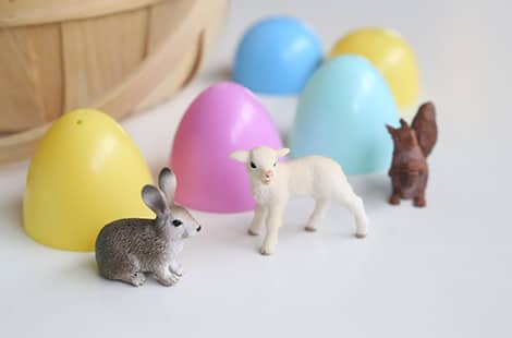Small animal figurines among the colourful plastic eggs.