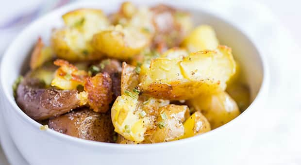 Smashed potatoes in a bowl
