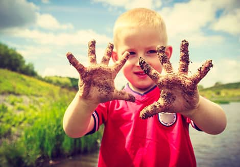 kid with messy hands