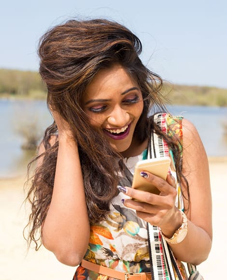 woman looking beautiful as she looks at her phone