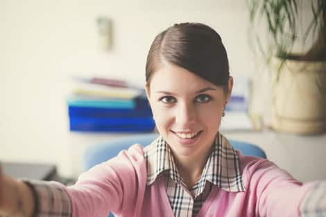 woman taking a selfie at her desk
