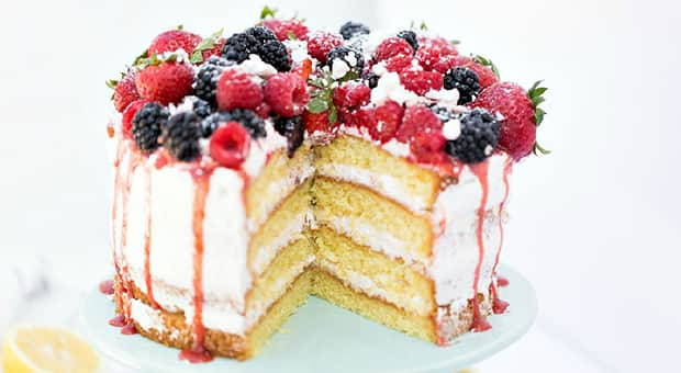 White sponge cake topped with colourful blackberries and raspberries.