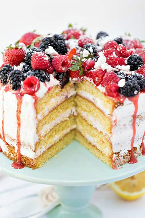 Missing piece of sponge cake reveals beautiful sponge and whipped cream layers.