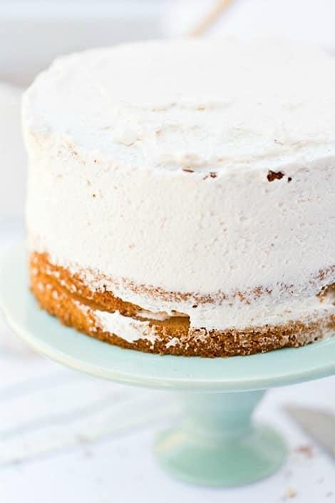 Whipped cream covering sponge cake.