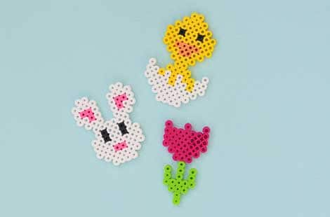 The completed perler design projects include: the bunny, the chick and the tulip.