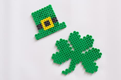 St. Patrick's Day leprechaun hat and shamrock made of perler beads.