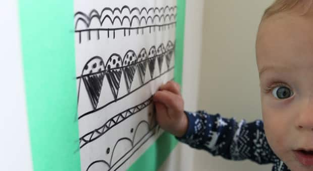 Baby interacting with sticky wall.