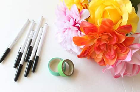 Pens, colourful flowers and floral tape.