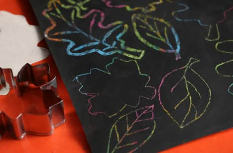 Cookie cutters and stencils beside fall leaf scratch art