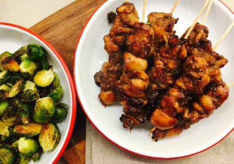 Teriyaki chicken skewers and roasted brussels sprouts in bowls