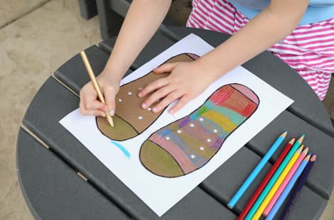 decorating the cardboard shoes