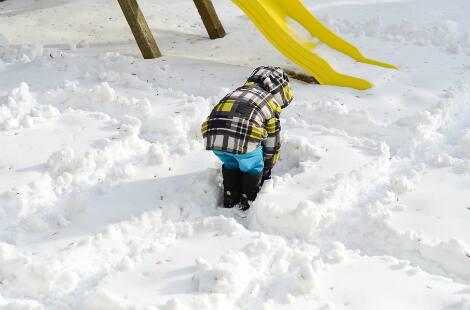A child making their way through the snow maze