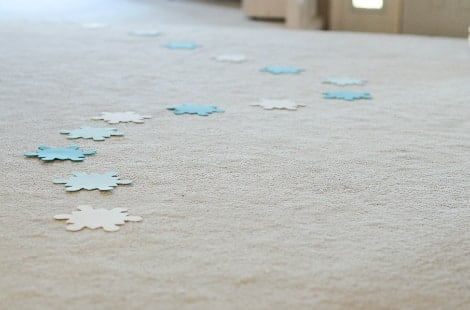 Foam snowflakes on a carpet