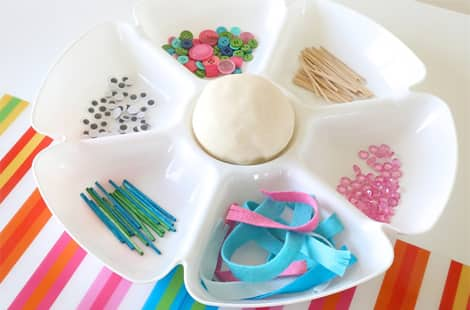 All the materials you'll need to make your snowmen on a divided tray