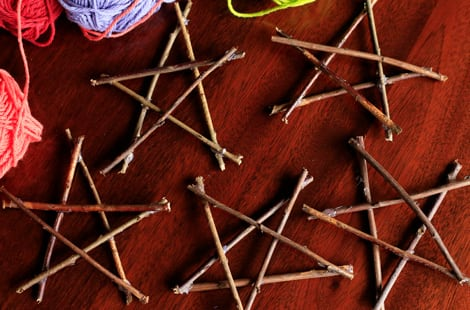 Several stars made of sticks on a table