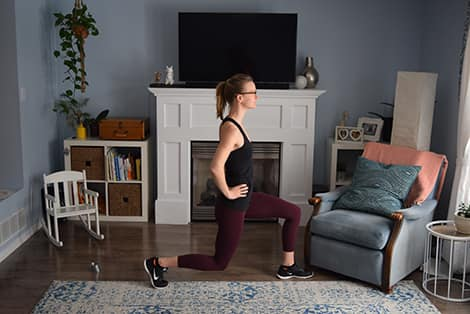 lucy doing lunges in her living room