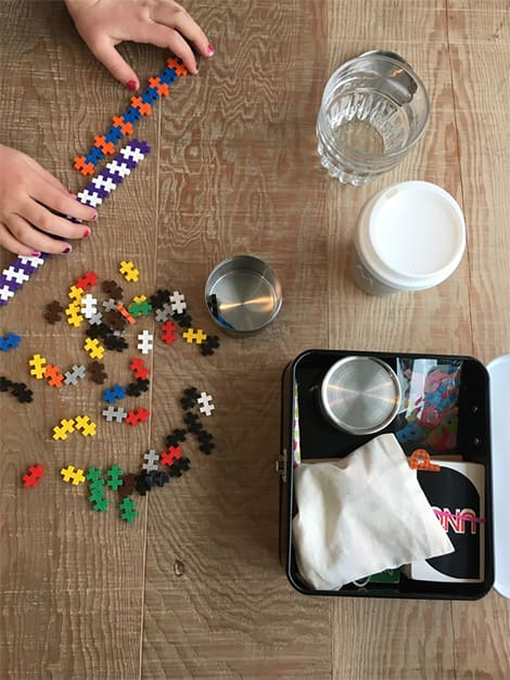 Child playing with her activity kit.