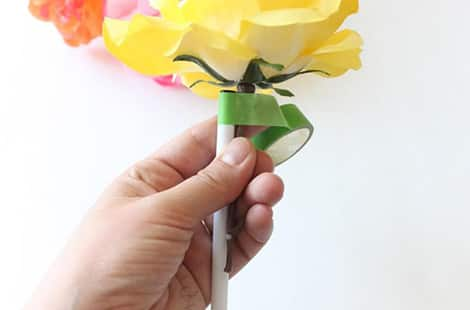 Tape around both pen and flower.