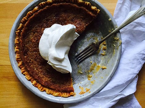 A photo of a pie with whipped cream on top
