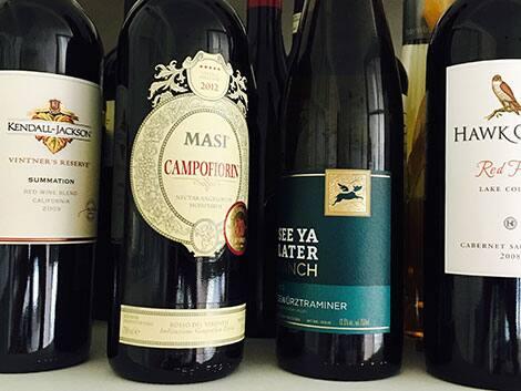 a photo of wine bottles lining the shelf