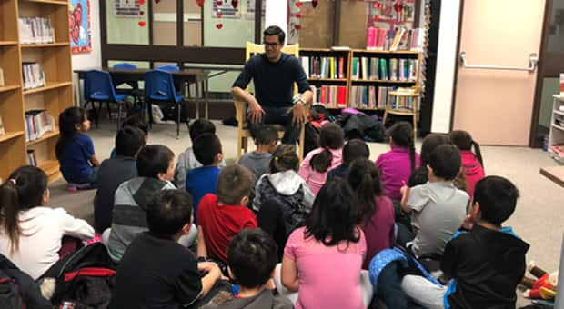David Robertson speaks to a group of children