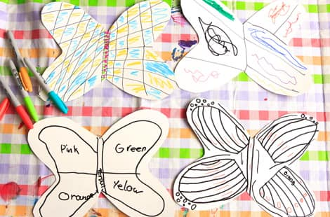 Designs drawn on paper of what the tissue paper butterflies will look like