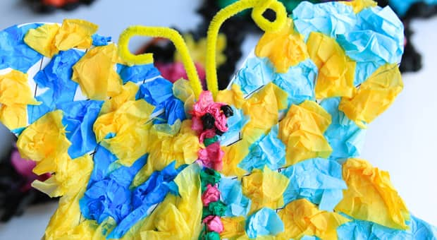 A happy, smiling, blue and yellow tissue paper butterfly