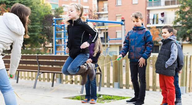 Children playing with a skipping rope