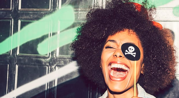 Image of a woman that hold pirate props