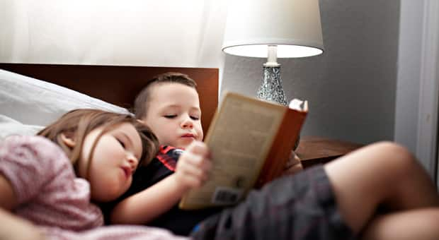 A boy and girl reading a book