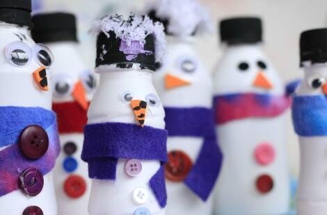 A bunch of completed yogurt bottle snowmen