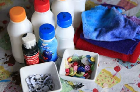 All the materials you'll need to make yogurt bottle snowmen