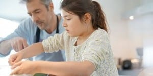 dad-cooking-w-daughter-123RF