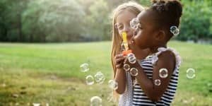 girls-blowing-bubbles-123RF
