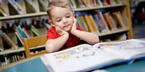 young-boy-reading-library