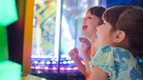 bright-colors-fun-person-play-happy-kids-arcade-neon-lights-excited-laughter-arcade-games_t20