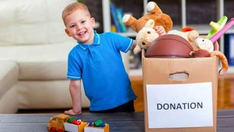 young-boy-with-donation-box