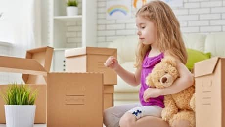 young-girl-packing-things-for-move