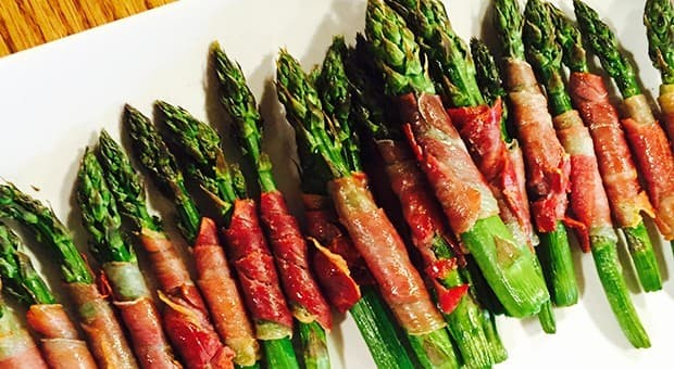A plate of prosciutto-wrapped asparagus.