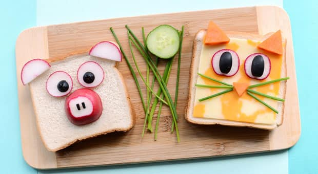 two sandwiches decorated as a pig and a cat