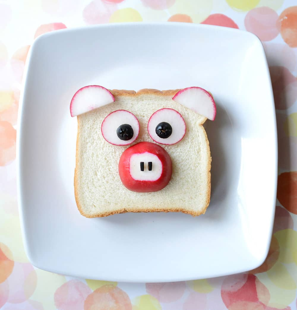 A sandwich decorated to look like a pig.