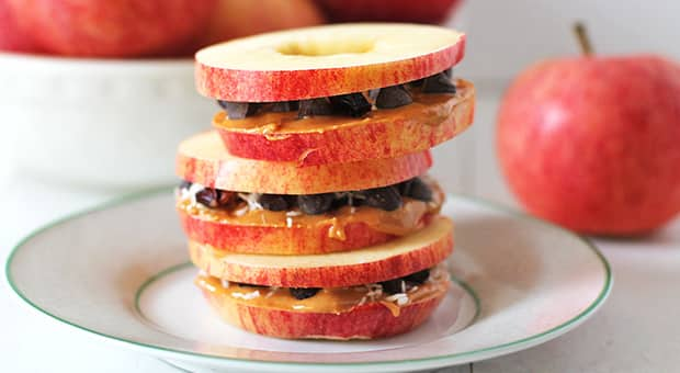 Three apple snack sandwiches stacked.