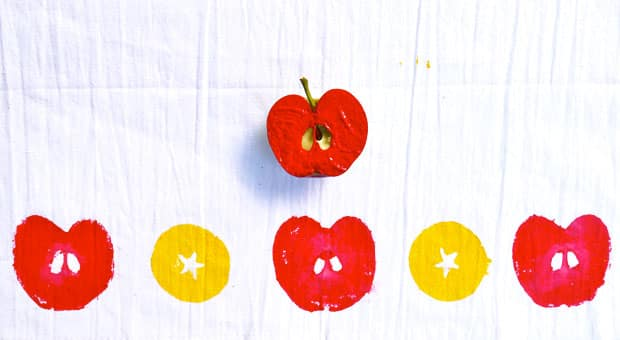 Apple stamps on a white tea towel.