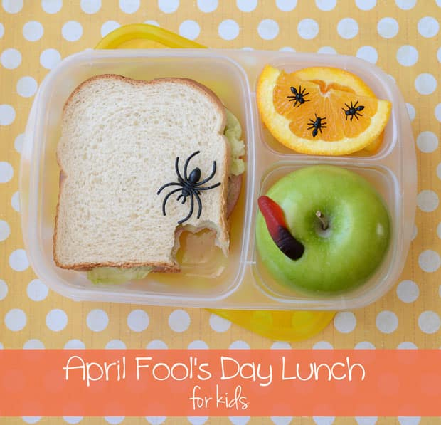 A school lunch covered with plastic bugs.