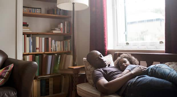 father takes a nap with his child