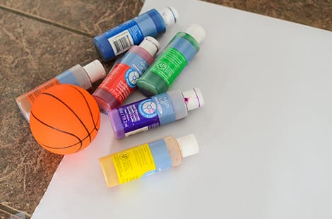 Paint supplies, paper and a basketball.