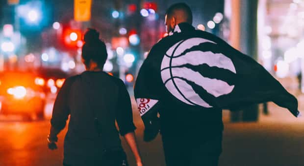 a photo of two people celebrating a Toronto Raptors victory