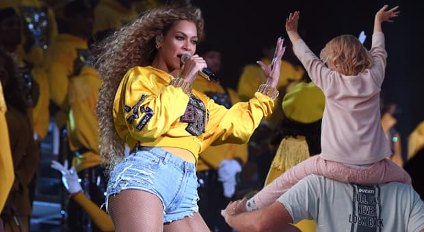 beyonce at coachella and a father with his daughter on his shoulders