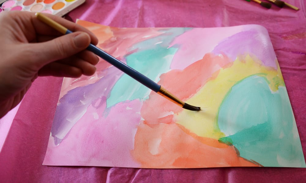 A piece of paper covered with bright watercolour paint.
